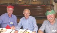 Money men Vic and Klaus in Christmas hats with our Auditor Peter