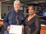 Graham receives Paul Harris Fellow from DG Patricia